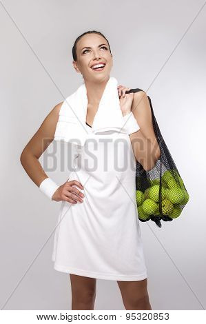 Closeup Portrait Of Professional Female Tennis Player Holding Plenty Of Balls In Mesh.