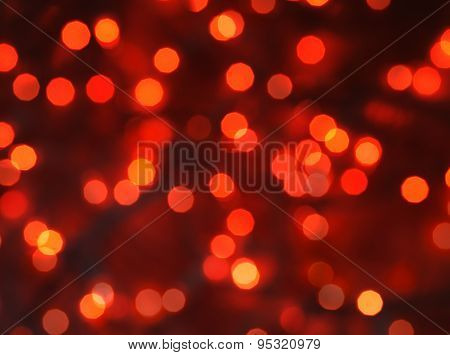 Lights on red background. abstract orange background with texture, holiday bokeh. Abstract Christmas