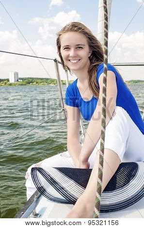 Happy Caucasian Woman Travelling On Yacht And Smiling