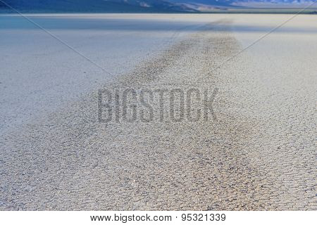 Stone Trace On Racetrack Playa Dry Lake In Death Valley National Park, California