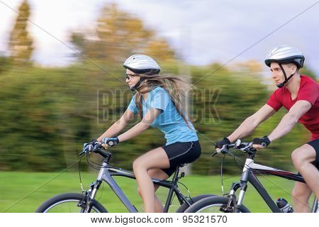 Sport Themes: Portrait Of Young Sportive Caucasian Couple Outdoors Having Time Together And Riding B