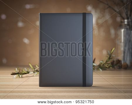 Notebook on the wooden table