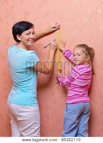Woman and little girl doing home repair