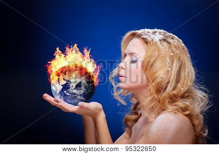 Frozen girl holding burning earth globe (east hemisphere) in palms (elements furnished by NASA) - version without glowing