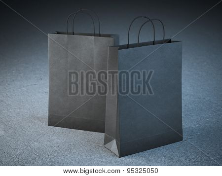 Two black paper bags with handles
