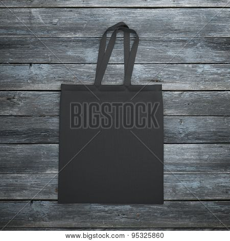 Black bag on the wooden table