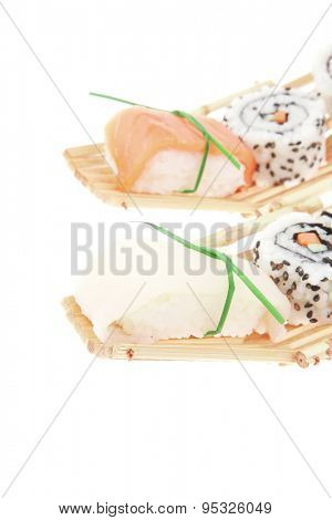 Maki Sushi and Sashimi - California Roll with Avocado and Salmon, Cream Cheese and Raw Salmon inside. Sahimi topped with raw Salmon and Eel . isolated over white background