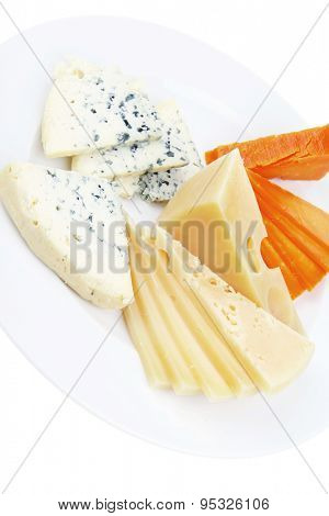 old blue stilton roquefort with orange cheddar and yellow parmesan and slices on plate with isolated over white background