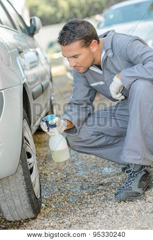 Mechanic cleaning a car