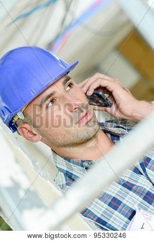 Builder talking on telephone
