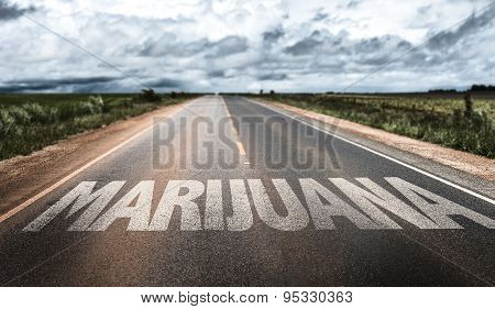 Marijuana written on rural road