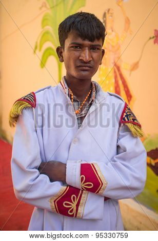 GODWAR REGION, INDIA - 15 FEBRUARY 2015: Young Indian musician dressed in wedding ceremony outfit. Marriages in India are filled with ritual and celebration that continue for several days.