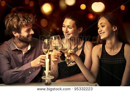 Friends drinking a glass of white wine