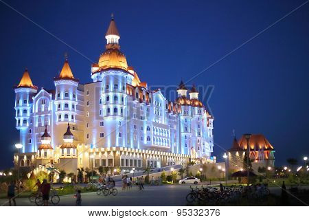 SOCHI, RUSSIA - JUL 27, 2014: Building of the Hotel Bogatyr in the style of a medieval castle in the evening