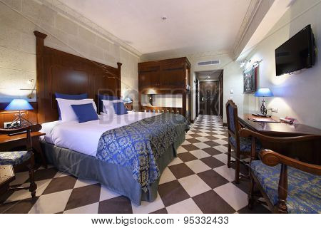 SOCHI, RUSSIA - JUL 27, 2014: Interior of double family superior room with a double bed and a bunk bed in the Hotel Bogatyr