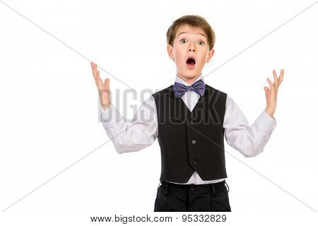A boy in a suit shouts surprised, scared, shock. Fashion kids. Education. Isolated over white.