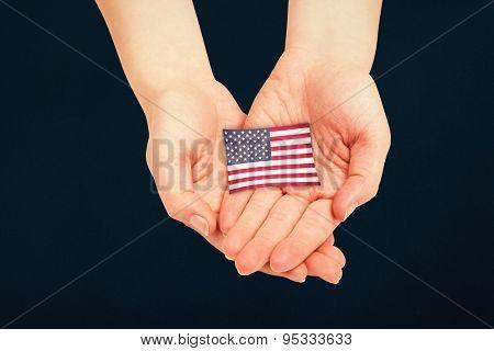 Hands presenting against blue background