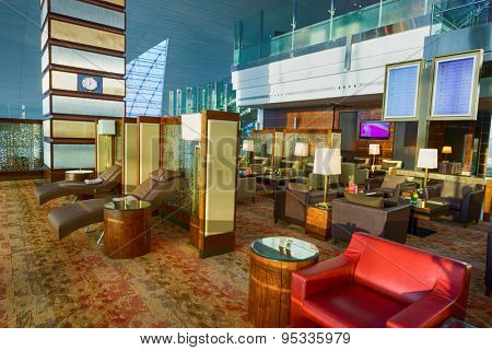 DUBAI, UAE - OCTOBER 17, 2013: Emirates business class lounge interior. Emirates is the largest airline in the Middle East, operating from its hub at Dubai International Airport