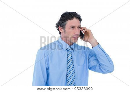 Businessman having phone call against a white background
