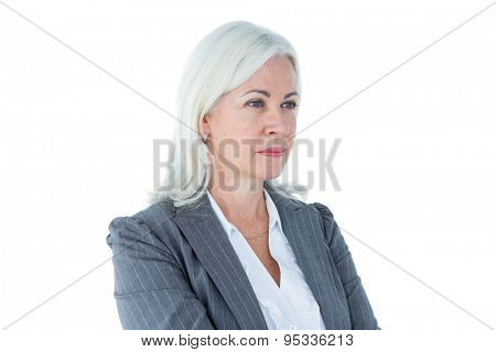 Confident businesswoman arms crossed on white background