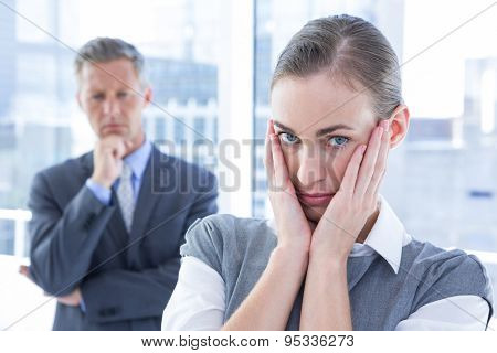 Businesswoman with hands on her face in the office