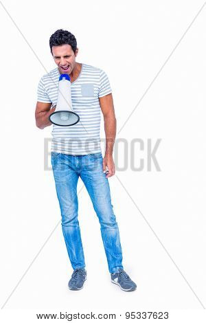 Standing man shouting through megaphone on white background