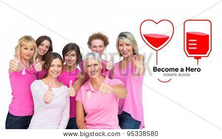 Positive women posing and wearing pink for breast cancer against blood donation