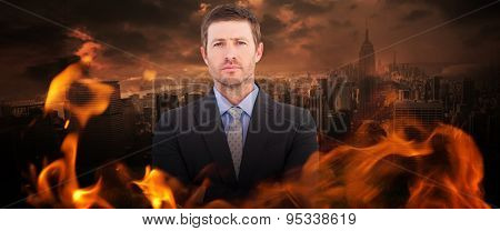 Businessman looking at the camera against stormy sky over city