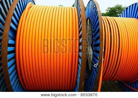 orange long cable on blue steel spool