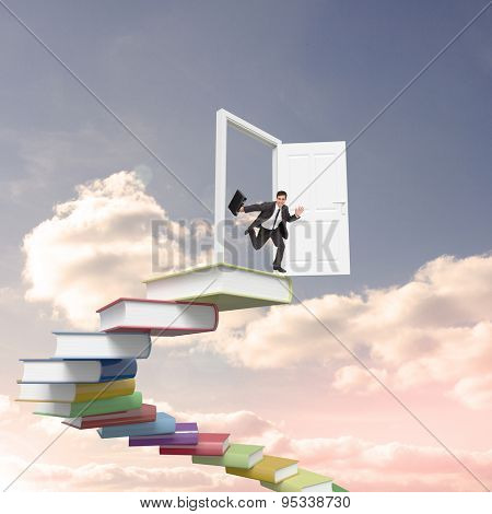 Smiling businessman in a hurry against blue sky with white clouds