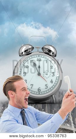 Businessman shouting at phone against curved cityscape