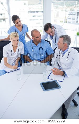 Team of doctors discussing during meeting in medical office