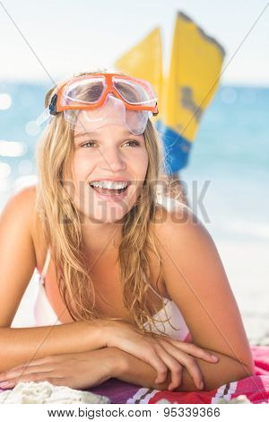 pretty blonde with snorkel and flippers at the beach