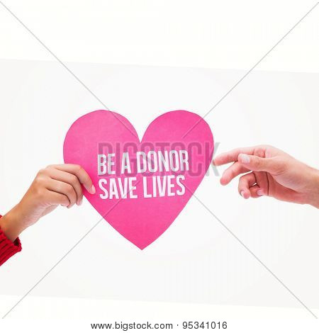 Woman passing man pink heart against be a donor save lives