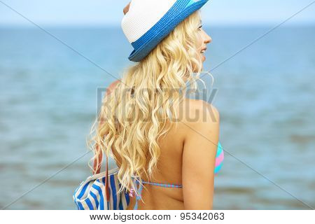 A beautiful young woman at the beach