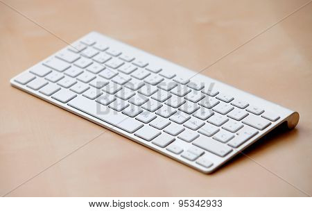 Silver computer keyboard over wooden surface