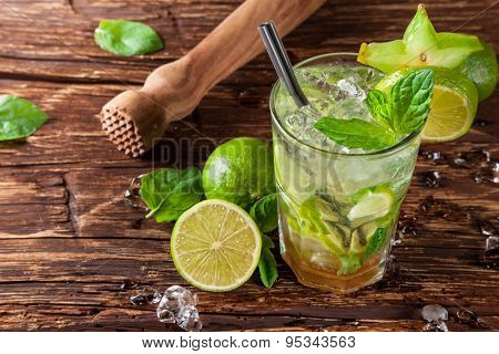 Mojito drink served on wooden planks