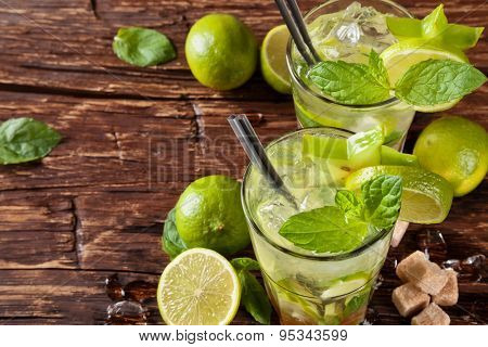Mojito drinks served on wooden planks