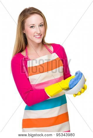 Caucasian woman wash the dishes