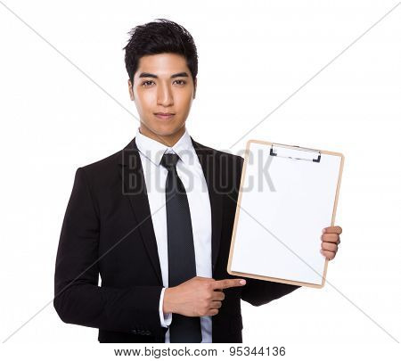 Indian businessman show with the blank page of the clipboard