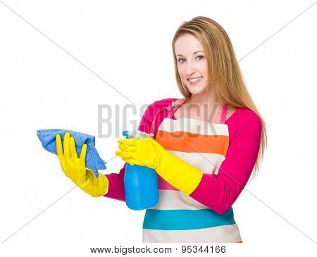 Woman using the bottle spray and rag for cleaning