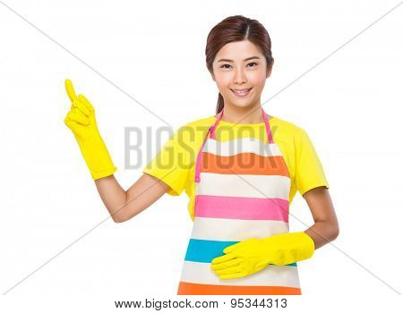 Housewife with plastic gloves and finger point up