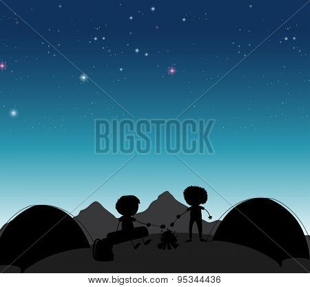 Silhouette boys camping out at night time