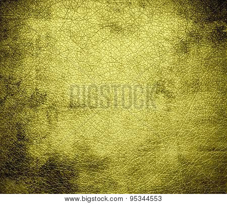 Grunge background of citrine leather texture