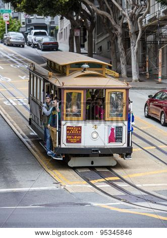 San Francisco, CA, USA - June 22nd, 2015: Tourists riding on a cable car in San Francisco