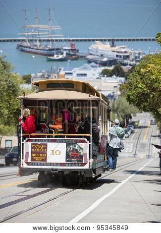 San Francisco, CA, USA - June 23rd, 2015: Tourists riding on a cable car in the Russian Hill district of San Francisco