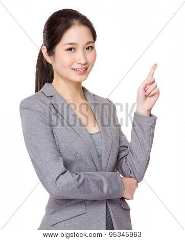 Businesswoman for finger point up selling something