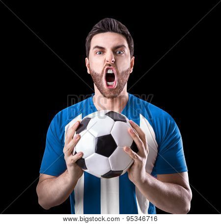 Fan on blue and white uniform celebrates on black background