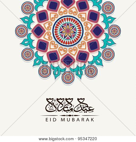 Beautiful floral design and Arabic calligraphy of text Eid Mubarak decorated greeting card design for Islamic holy festival, celebration.