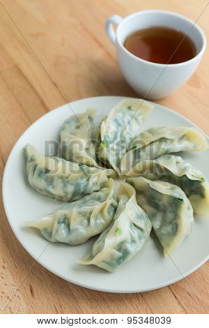 Chinese meat dumpling with a cup of tea